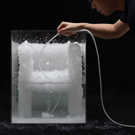 Tokujin Yoshioka demonstrating the process of creating a crystal chair prototype.