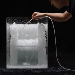 Tokujin Yoshioka demonstrating the process of creating a crystal chair prototype.