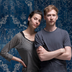 Sarah van Gameren and Tim Simpson stand infront of their Blueware wall piece.