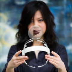 Tan Le with her design for a headset that can read its user's branwaves to control virtual and physical electronics.