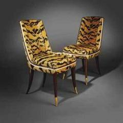 'Rothermere/Dubly', A Pair of Macassar Ebony re-upholstered chairs by Emile-Jacques Ruhlmann