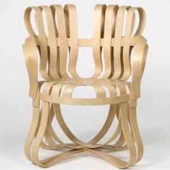 Cross Check armchair, Knoll, 1989-91, bent/laminated maple by Frank Gehry