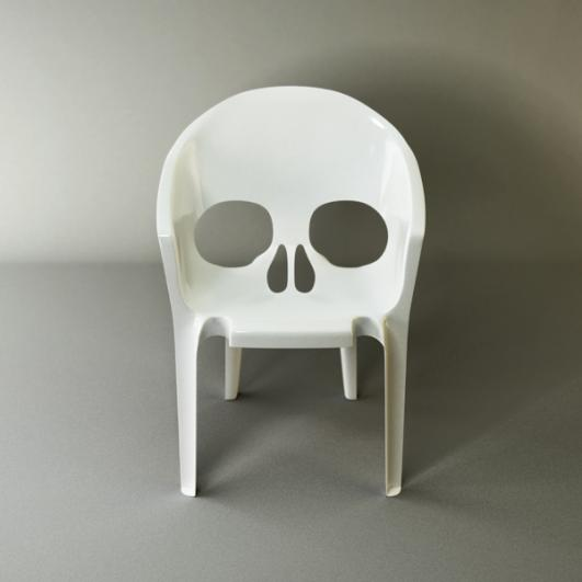 """Souviens toi que tu vas mourir"" (Remember that you will die) chair by Pool"