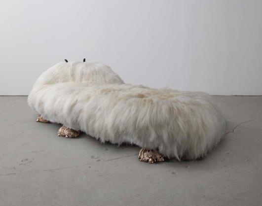 Unique Anna Nicole daybed from the Beast series, in white Icelandic sheep fur with zig-zag carved wooden horns and cast bronze camel toe feet. Designed and made by The Haas Brothers