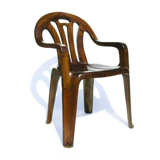 'Plastic Chair In Wood' by Maarten Baas, 2008. Carved camphor wood with varnish