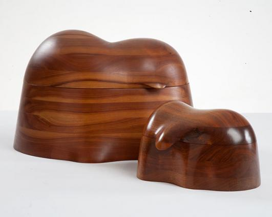 "Unique jewelry boxes in stack-laminated walnut. Designed and made by Wendell Castle, Rochester, New York, 1973 and 1975. Signed and dated ""WC 73"" and ""WC 75."""