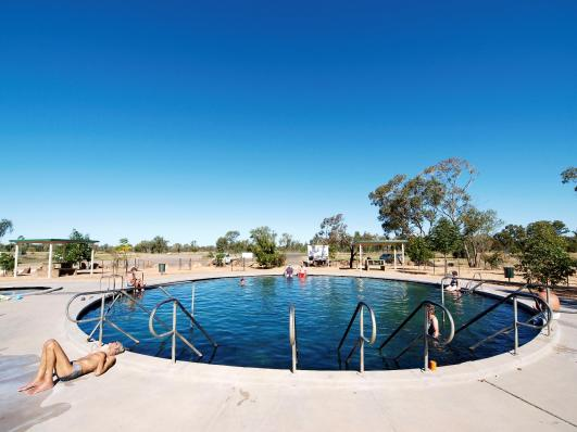 Visitors enjoying the Lightning Ridge hot artesian baths, northern New South Wales. Photo: Simon Bayliss, courtesy of Lightning Ridge Tourism Association