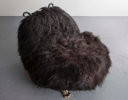 Unique Hairy-Kate Olson lounge chair from the Beast series, in black Icelandic sheep fur, with carved ebony horns and cast bronze coyote feet. Designed and made by The Haas Brothers