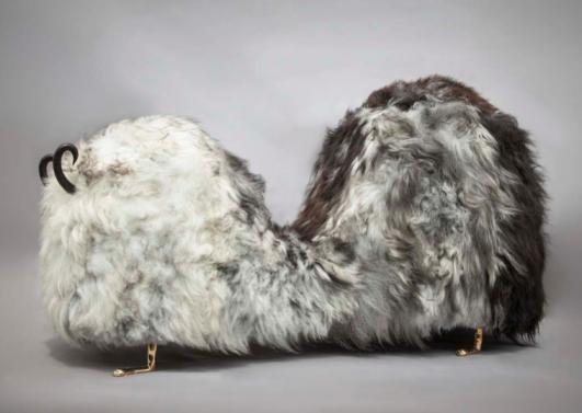 Unique Hairy J. Blige double-hump bench from the Beast series, in Salt N' Pepper Icelandic sheep fur, with carved ebony horns, cast bronze lion feet, and cast bronze tits and a pussy. Designed and made by The Haas Brothers