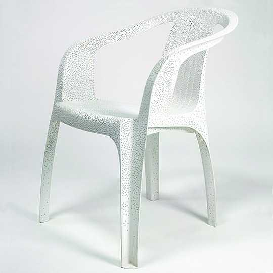 'White Plastic Chair' by Tina Roeder, as part of her series of found/old/decaying garden chairs, 2002.  Individually perforated and sanded in order to give a new lease of life.